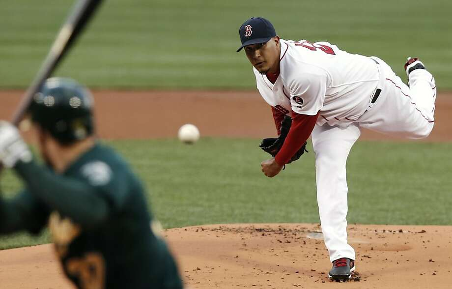 Boston Red Sox starting pitcher Felix Doubront delivers against the Oakland Athletics during the first inning of a baseball game at Fenway Park in Boston on Monday, April 22, 2013. (AP Photo/Winslow Townson) Photo: Winslow Townson, Associated Press