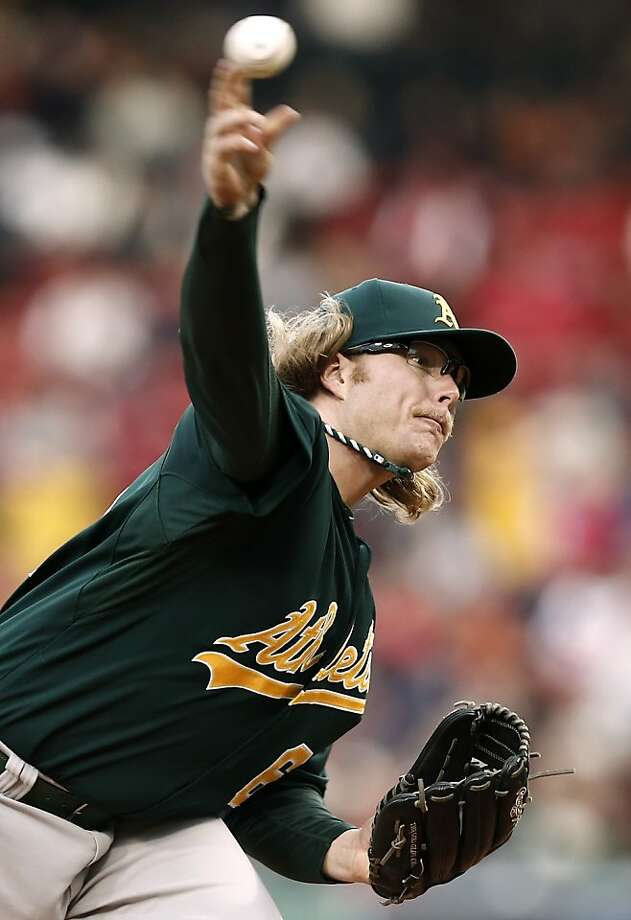 Oakland Athletics starting pitcher A.J. Griffin delivers against the Boston Red Sox during the first inning of a baseball game at Fenway Park in Boston on Monday, April 22, 2013. (AP Photo/Winslow Townson) Photo: Winslow Townson, Associated Press