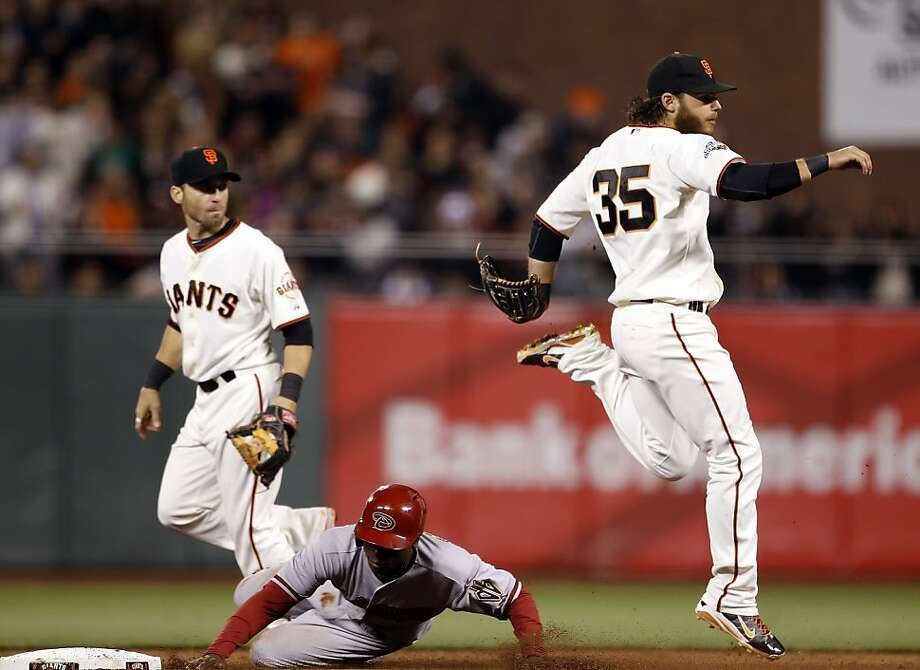 Brandon Crawford completes the double play on Didi Gregrorius in the sixth inning. The San Francisco Giants played the Arizona Diamondbacks at AT&T Park in San Francisco, Calif., on Monday, April 22, 2013, winning 5-4 on a walk-off hit by Brandon Belt. Photo: Carlos Avila Gonzalez, The Chronicle