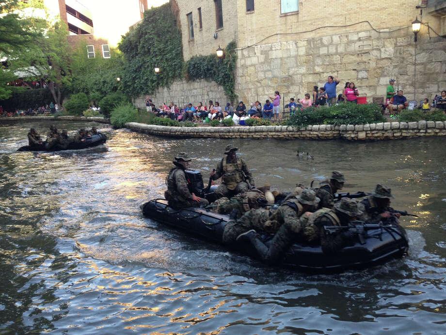 A float glides down the San Antonio River during the Texas Cavaliers River Parade on Monday, April 22, 2013. Photo: Benjamin Olivo / San Antonio Express-News