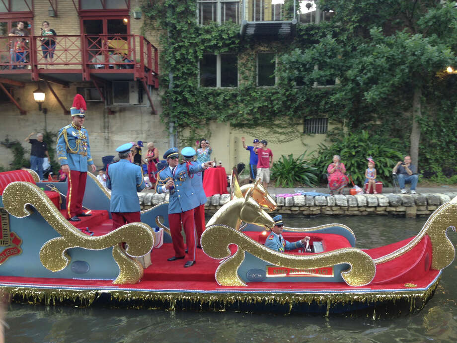 King Antonio's float glides down the San Antonio River during the Texas Cavaliers River Parade on Monday, April 22, 2013. Photo: Benjamin Olivo / San Antonio Express-News