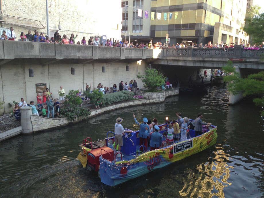 The float of parade Grand Marshal actor Thomas Gibson glides down the San Antonio River during the Texas Cavaliers River Parade on Monday, April 22, 2013. Photo: Benjamin Olivo / San Antonio Express-News