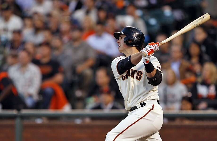 Buster Posey watches his first inning double hit the wall in right center field. The hit would score Pablo Sandoval from second base. The San Francisco Giants played the Arizona Diamondbacks at AT&T Park in San Francisco, Calif., on Monday, April 22, 2013, winning 5-4 on a walk-off hit by Brandon Belt. Photo: Carlos Avila Gonzalez, The Chronicle