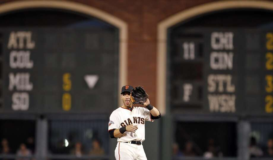 Marco Scutaro, apparently giving a signal during a Giants game in April 2013, hopes to return to the lineup this weekend. Dealing with a bad back, Scutaro last played Sept. 15. Photo: Carlos Avila Gonzalez, The Chronicle