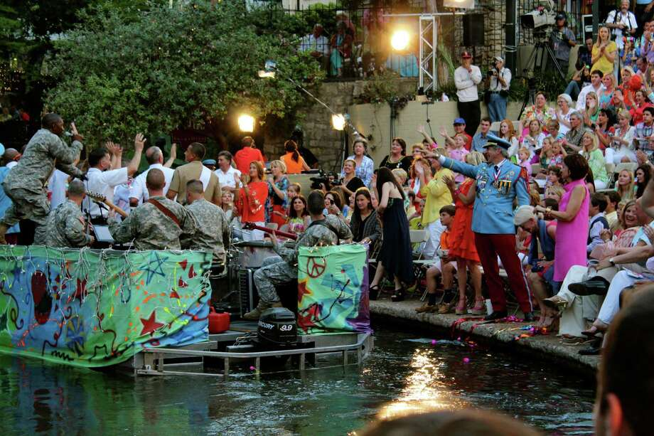 Fiesta goers take in the Texas Cavaliers River Parade on Monday, April 22, 2013. Photo: Yvonne Zamora, MySA.com