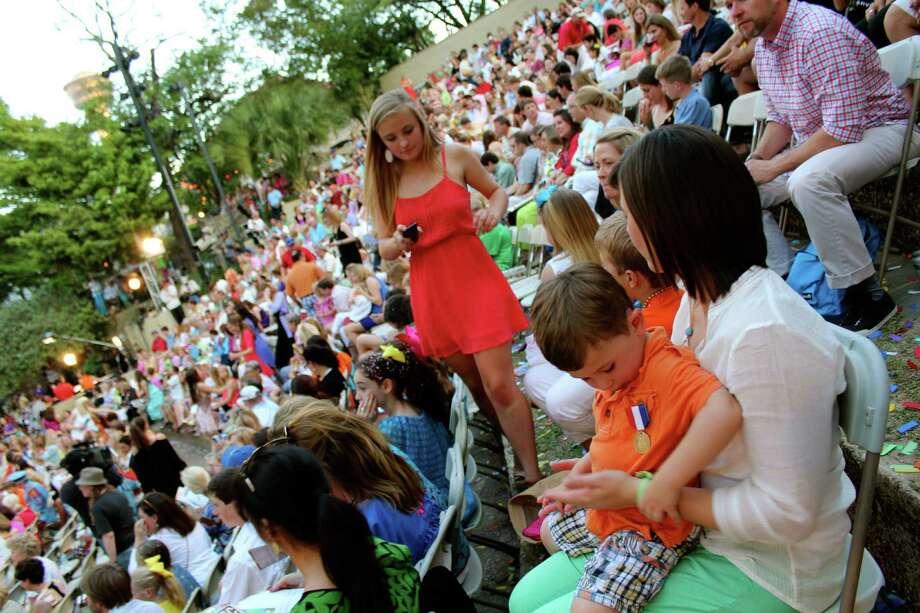 Fiesta goers take in the Texas Cavaliers River Parade on Monday, April 22, 2013. Photo: Yvonne Zamora, MySA.com