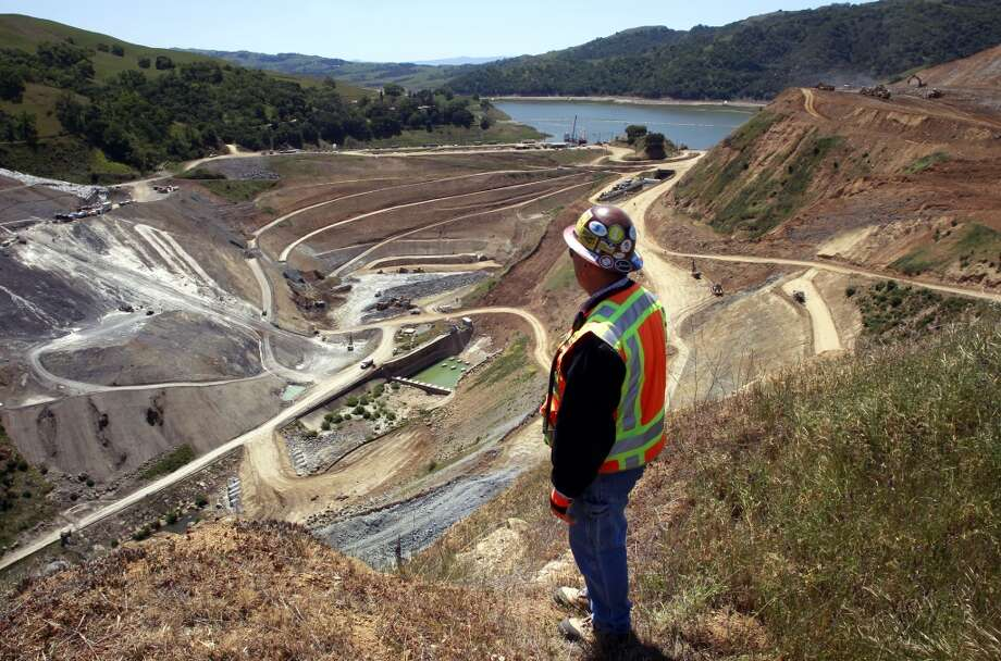 John Rocca, construction manager looks over the Calaveras Dam Replacement Project, with Calaveras Reservoir just beyond, on Thursday April 18, 2013, in Fremont, Ca. Construction on the project will be delayed two years and add $100 million to the cost due to the unstable ground beneath the dam. Calaveras Reservoir is San Francisco\'s largest storage site in the Hetch Hetchy water system.
