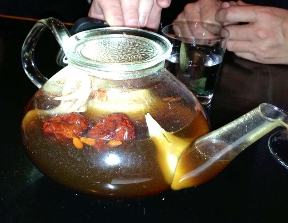 Whole squab steeping in the teapot for the double bouillon.
