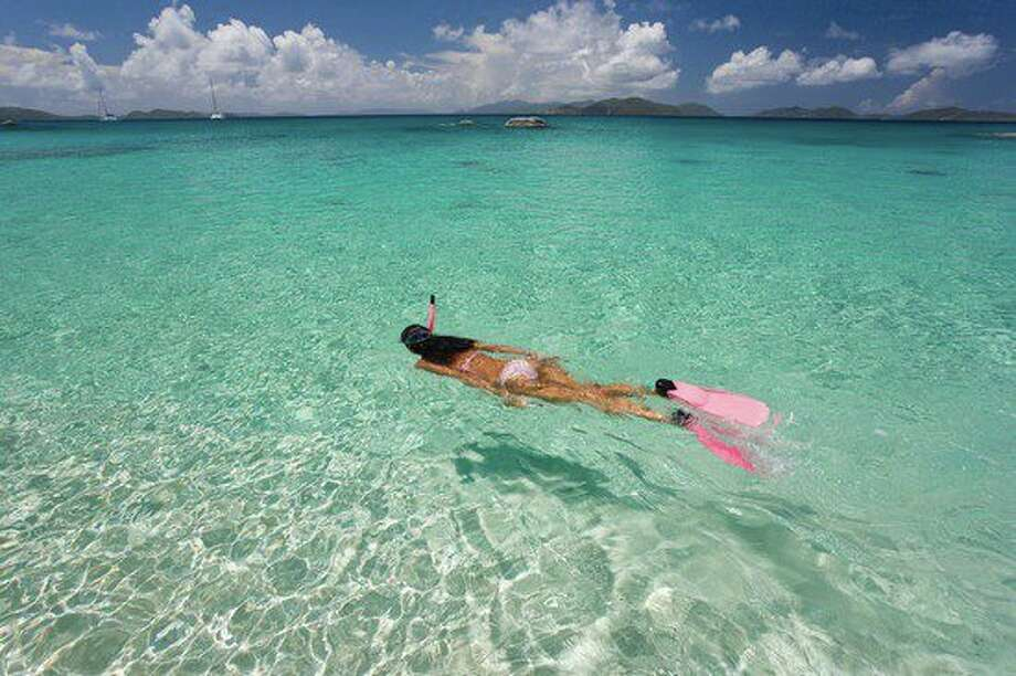 The brilliantly clear waters of the Indian Ocean make snorkeling a popular activity in Zanzibar, where the Zanzi Resort offers villas with private beaches.