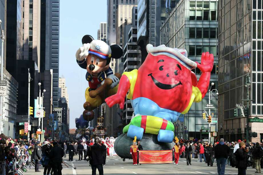 The Kool-Aid Man balloon and the Mickey Mouse balloon during the 86th annual Macy's Thanksgiving Day Parade in New York, Nov. 22, 2012. (Librado Romero/The New York Times) Photo: LIBRADO ROMERO / NYTNS