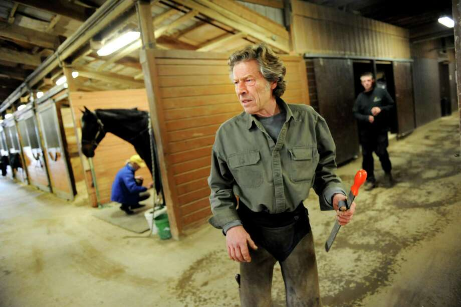 Farrier Jim Santore stands in the barn as he awaits his next customer on Tuesday, April 9, 2013, at Van Lennep Riding Center in Saratoga Springs , N.Y. (Cindy Schultz / Times Union) Photo: Cindy Schultz, Albany Times Union / 10021904A