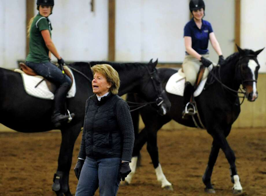 Cindy Ford, center, director of riding for Skidmore College and coach of the women's equestrian team, works with riders on Tuesday, April 9, 2013, at Van Lennep Riding Center in Saratoga Springs , N.Y. (Cindy Schultz / Times Union) Photo: Cindy Schultz, Albany Times Union / 10021904A