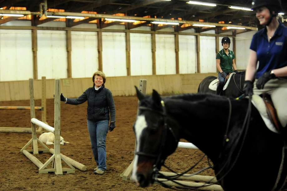 Cindy Ford, left, director of riding for Skidmore College and coach of the women's equestrian team, works with riders on Tuesday, April 9, 2013, at Van Lennep Riding Center in Saratoga Springs , N.Y. (Cindy Schultz / Times Union) Photo: Cindy Schultz, Albany Times Union / 10021904A