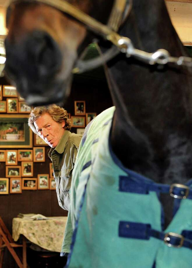 Farrier Jim Santore clucks at Tobey after shoeing him on Tuesday, April 9, 2013, at Van Lennep Riding Center in Saratoga Springs , N.Y. (Cindy Schultz / Times Union) Photo: Cindy Schultz, Albany Times Union / 10021904A