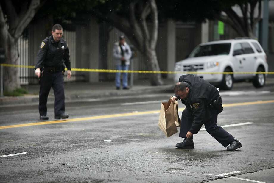 Officers collect evidence on Mission Street where a pedestrian was struck by a vehicle and seriously injured. Photo: Lea Suzuki, The Chronicle