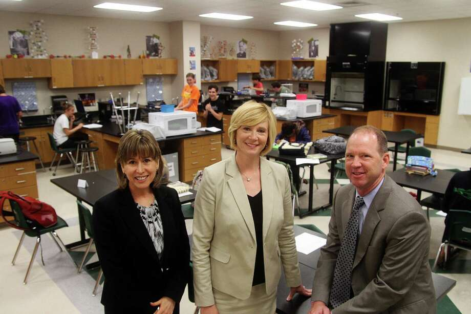 Karen Engle, left, Clear Falls High School principal; Stephanie McBride, Mossman Elementary principal; and Jamey Majewski, Bayside Intermediate principal, are integral in implementing science and technology courses at the Education Village in Clear Creek Independent School District.Karen Engle, left, Clear Falls High School principal; Stephanie McBride, Mossman Elementary principal; and Jamey Majewski, Bayside Intermediate principal, are integral in implementing science and technology courses at the Education Village in Clear Creek Independent School District. Photo: Pin Lim, Freelance / Copyright Pin Lim.
