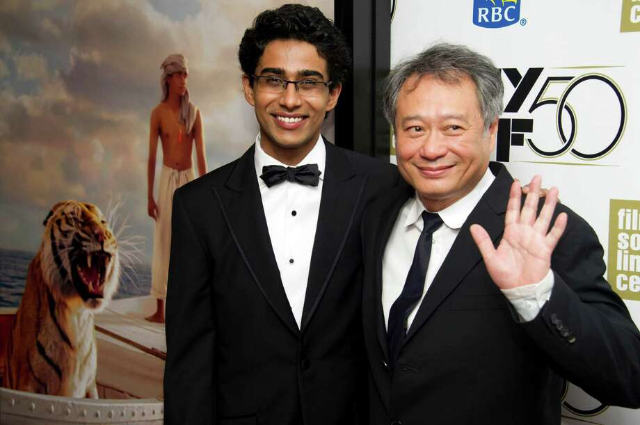 "FILE - This Sept. 28, 2012 file photo shows director Ang Lee, right, and actor Suraj Sharma at the premiere of ""Life of Pi"" at the 50th annual New York Film Festival in New York. Sharma credits director Ang Lee with setting him on a path to continue with a career in movies.  Sharma told The Times of India in an interview published Tuesday, April 23, 2013, that getting to work with the Oscar-winning director on ""Life of Pi"" was a blessing. ""The amount I learned and did was awesome. Ang gave me a path. Before that, I didn't even know what I would do in life,"" he was quoted as saying. After making the movie, ""I know I want to tell stories,"" he said.  (Photo by Charles Sykes/Invision/AP, file) Photo: Charles Sykes"