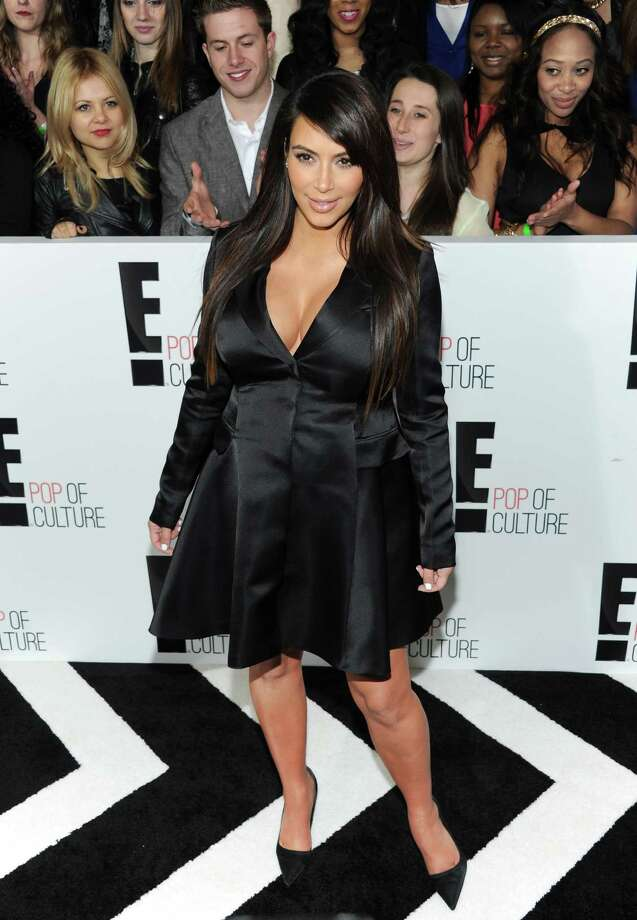"""Kim Kardashian from """"Keeping Up With The Kardashians"""" attends the E! Network 2013 Upfront at the Manhattan Center on Monday, April 22, 2013 in New York. (Photo by Evan Agostini/Invision/AP) Photo: Evan Agostini"""