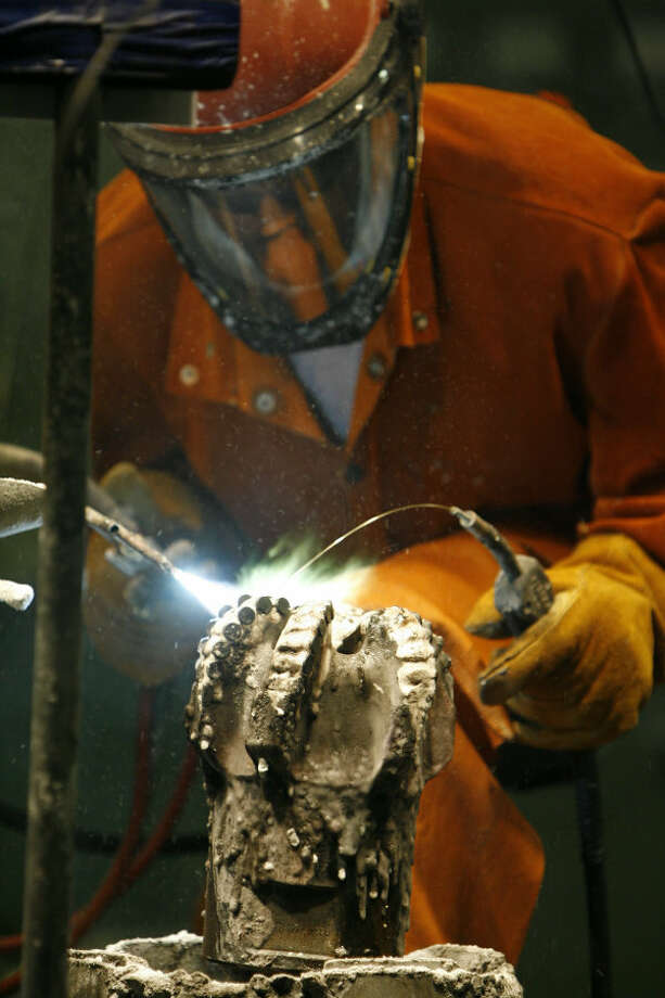 Lynn Franklin brazing a PDC (polycrystalline diamond compact) bit at Halliburton's Security Drill Bits unit in Conroe in 2007. Photo: Melissa Phillip, Houston Chronicle