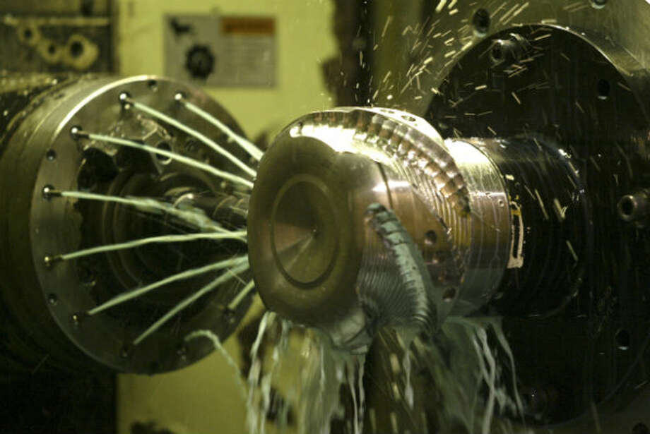 Sparks fly as a bit is machined at Halliburton's Waverly plant. The company's market value, at $9.3 billion, makes it No. 8 on the list. Photo: Buster Dean, Houston Chronicle