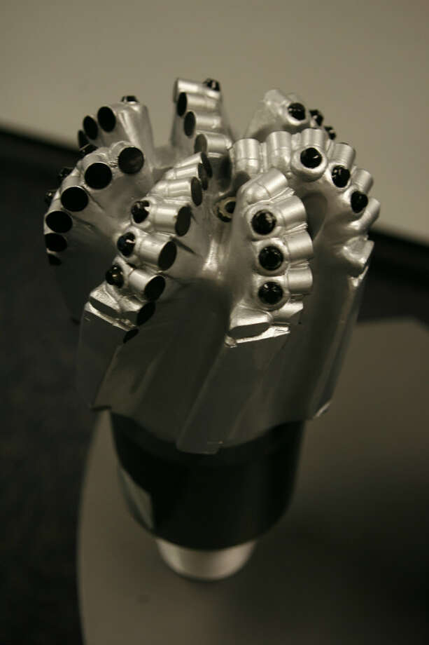 A 7 7/8 inch PDC (polycrystalline diamond compact) bit at Halliburton's Security Drill Bits unit in Conroe in 2007. Photo: Melissa Phillip, Houston Chronicle