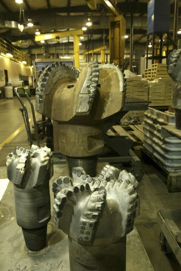 Drill bits wait their turn to be refurbished, 5/20/03, at Halliburton's Waverly facility.  (Buster Dean / Chronicle) Photo: Buster Dean, Houston Chronicle