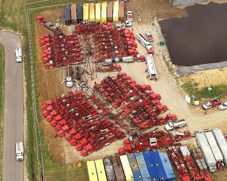 Crews operating dozens of pieces of equipment conduct fracturing treatment at a Dan A. Hughes Co. well in the Barnett Shale near Denton in North Texas. Photo: Halliburton / handout email
