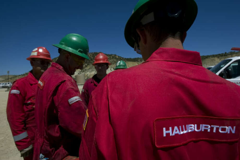 "A group of workers from Halliburton work on a hydraulic fracturing site where ""tight gas"" was pumped from the ground in the Piceance Basin on the western slope of the Rocky Mountains, in 2009. Photo: Johnny Hanson, Houston Chronicle"