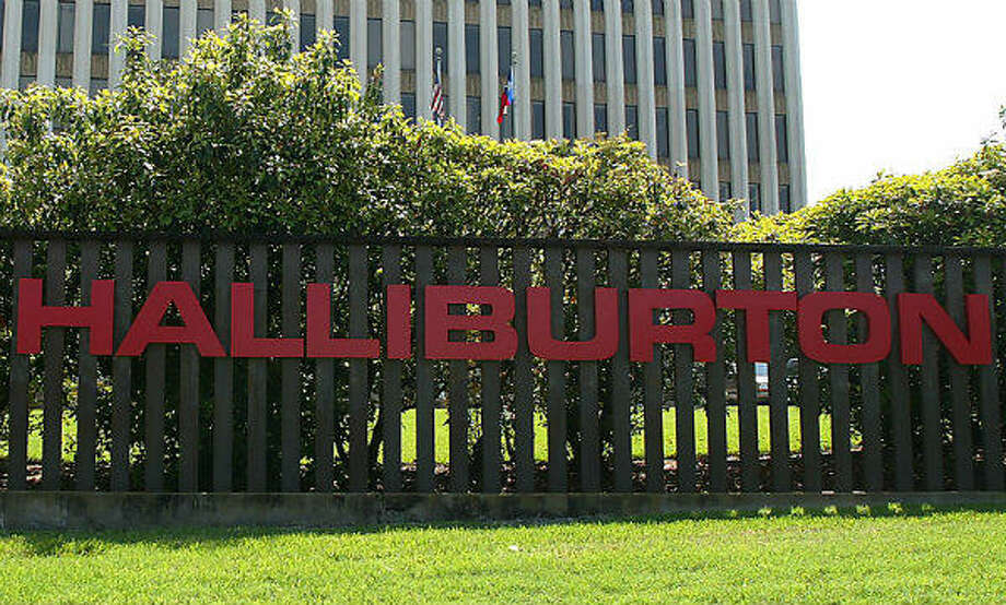 Halliburton Company's building is shown March 27, 2003 in Houston, Texas. Halliburton, formerly headed by U.S. Vice President Dick Cheney, stands to make hundreds of millions of dollars in addition to the contracts it has already been awarded under a no-bid contract awarded by the U.S. Army Corps of Engineers, according to newly available documents. Photo: James Nielsen, Getty Images