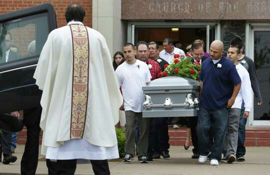 Pall bearers carry the casket of Mariano C. Saldivar, 57, who was killed by the blast in West, TX, in his apartment which was close to the explosion. This was the first of many funeral services to be held at St. Mary's Catholic Church of the Assumption, on Tuesday April 23, 2013. Photo: Bob Owen, San Antonio Express-News / ©2013 San Antonio Express-News