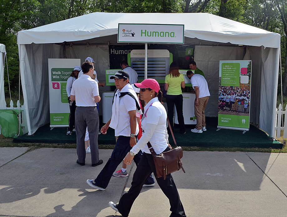 Humana passed out pedometers, such as those at left,  to Shell Houston Open spectators to encourage participation in a contest to see which PGA-tournament city could log the most miles. Photo: Courtesy Of Humana
