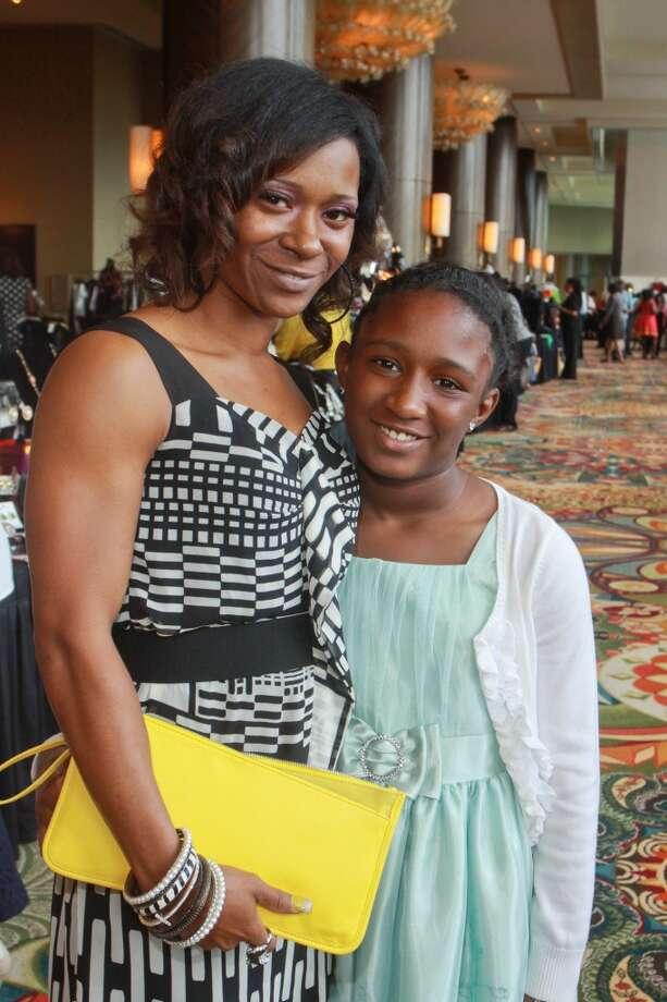 (For the Chronicle/Gary Fountain) Rayya Carrington, left, and Jahari Ennols