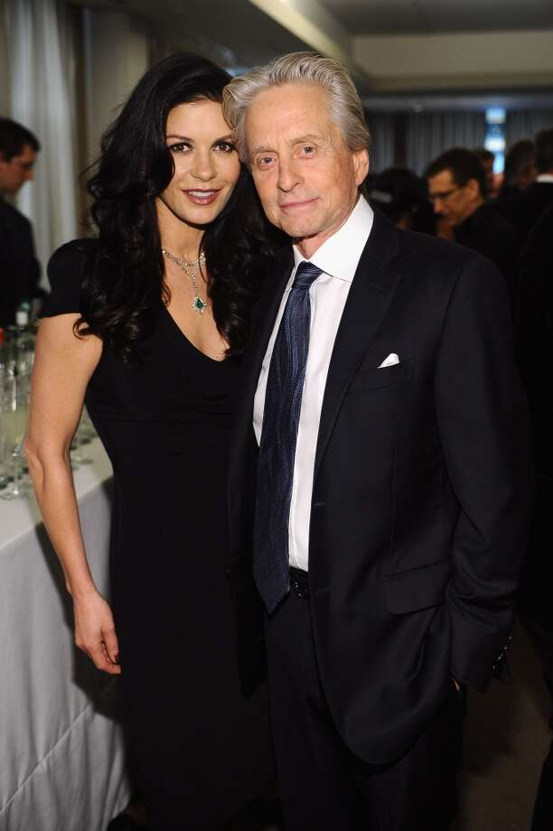 NEW YORK, NY - APRIL 22:  Michael Douglas (R) and Catherine Zeta Jones attend the Grey Goose cocktail reception of The Film Society of Lincoln Center\'s 40th Chaplin Award Gala at Avery Fisher Hall, Lincoln Center on April 22, 2013 in New York City.  (Photo by Stefanie Keenan/Getty Images for GREY GOOSE)