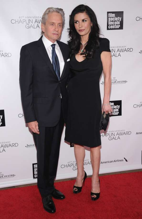 NEW YORK, NY - APRIL 22:  Michael Douglas (L) and Catherine Zeta Jones attend the 40th Anniversary Chaplin Award Gala at Avery Fisher Hall at Lincoln Center for the Performing Arts on April 22, 2013 in New York City.  (Photo by Jamie McCarthy/Getty Images)