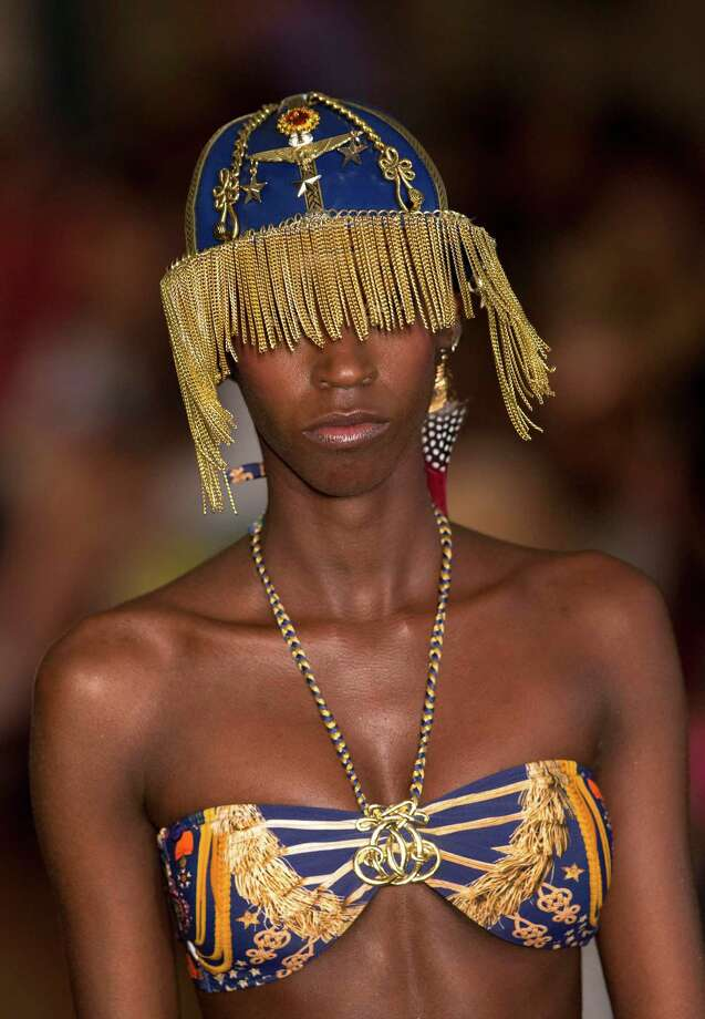 A model wears a creation from the Blue Man summer collection during Fashion Rio, in Rio de Janeiro, Brazil, Tuesday, April 16, 2013. (AP Photo/Silvia Izquierdo) Photo: Multiple