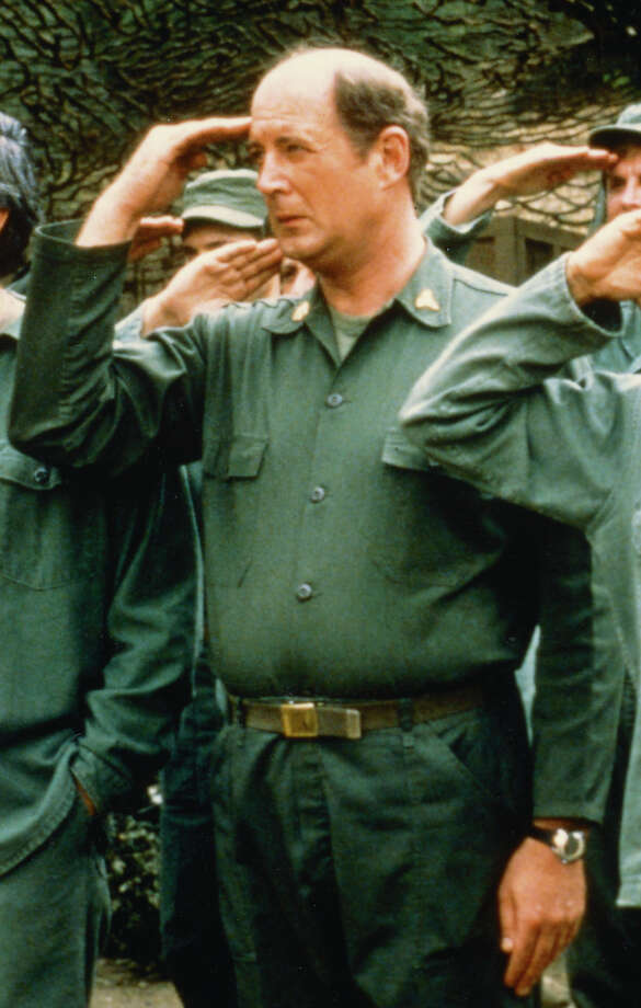 David Ogden Stiers saluting in a publicity still issued for the US television series 'M*A*S*H', USA, circa 1975. The medical comedy starred Stiers as Charles Emerson Winchester III. Photo: Silver Screen Collection, Getty Images / Moviepix