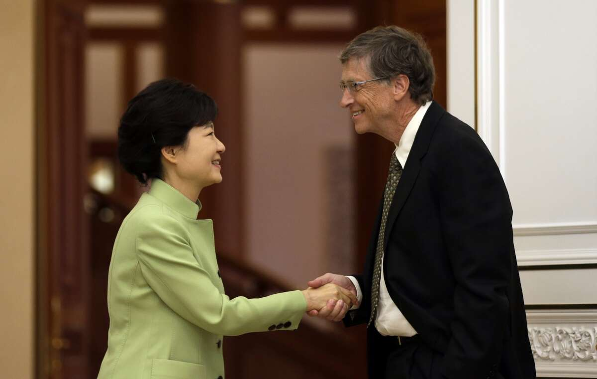 This is the handshake that has bruised a nation. South Korean President Park Geun-hye (L) shakes hands with Microsoft founder Bill Gates before their meeting at the presidential Blue House in Seoul on April 22, 2013. (LEE JIN-MAN/AFP/Getty Images)