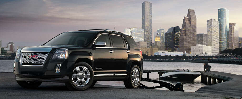 This advertising photo shows the GMC Denali in front of Houston's skyline. GMC modified the photo to include a large body of water. Photo: GMC.