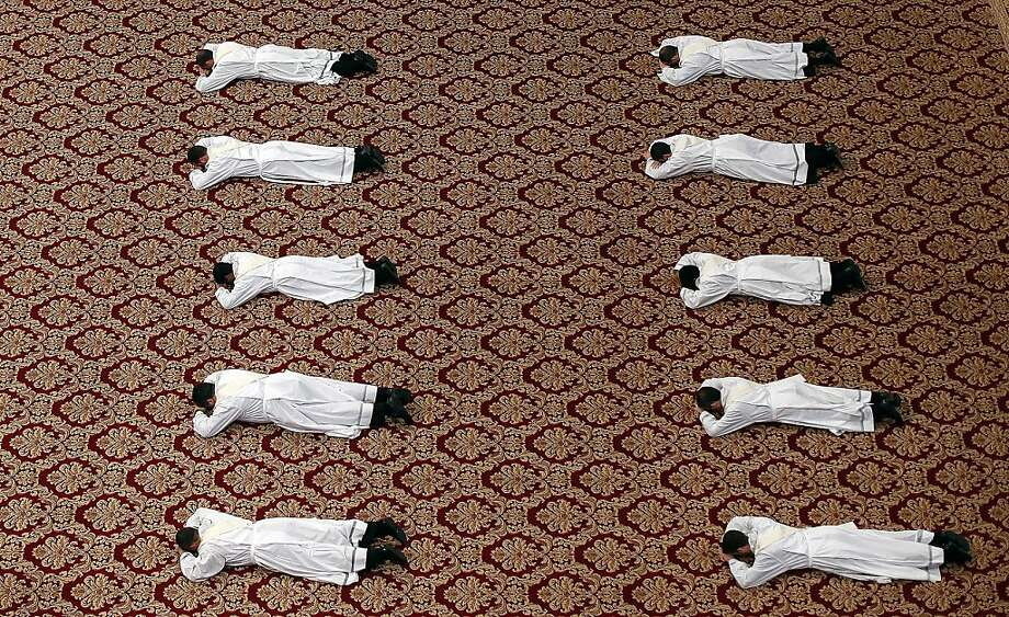 Priests prostate themselves during a Mass celebrated by Pope Francis during a priests ordination ceremony in St. Peter's Basilica at the Vatican. Photo: Alessandro Bianchi, AFP/Getty Images
