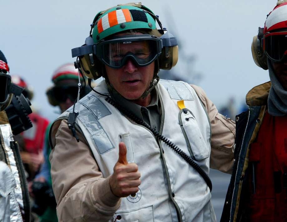 FILE - U.S. President George W. Bush gives a thumbs up as he visits the aircraft carrier USS Abraham Lincoln off the California coast on Thursday, May 1, 2003. Later in the day, he declared that major combat in Iraq was finished. (AP Photo/J. Scott Applewhite, File) Photo: J. Scott Applewhite, Associated Press / AP