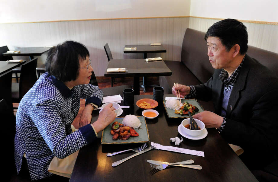 Amy Zhang, left of Ridgefield, and Wan Hin Zhang (no relation), of Flushing, N.Y., have lunch together at New Empire Szechuan Restaurant in Ridgefiel, Conn., Tuesday, April 16, 2013. Photo: Carol Kaliff / The News-Times