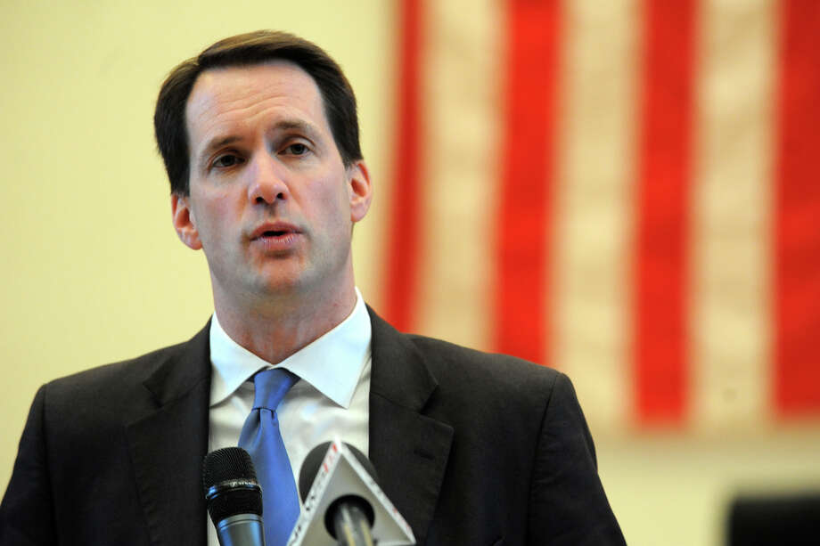 Congressman Jim Himes speaks at a ceremony marking the 26th anniversary of the L'Ambiance Plaza collapse held at City Hall, in Bridgeport, Conn., April 23rd, 2013. 28 workers were killed in the 1987 construction accident. Photo: Ned Gerard / Connecticut Post