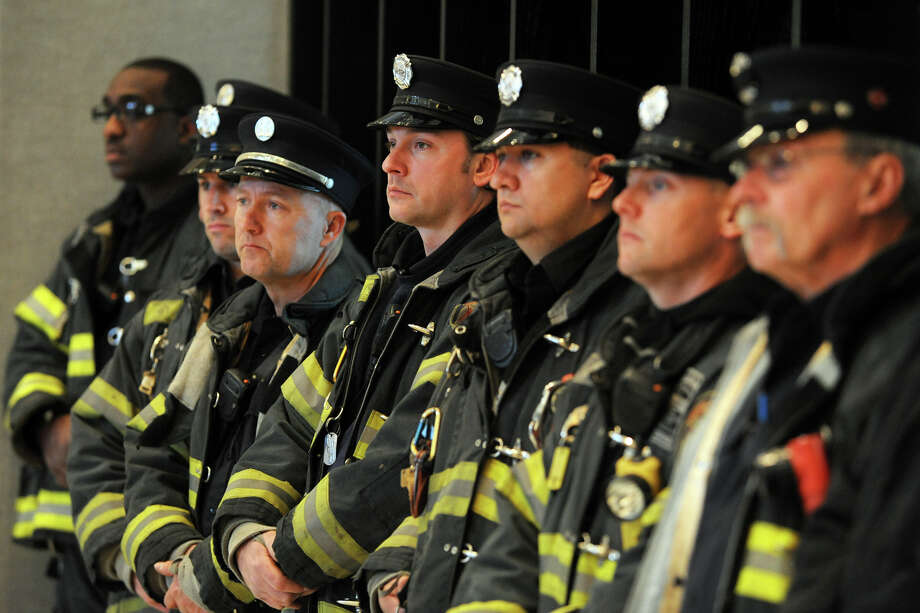 Bridgeport firefighters attend a ceremony marking the 26th anniversary of the L'Ambiance Plaza collapse held at City Hall, in Bridgeport, Conn., April 23rd, 2013. 28 workers were killed in the 1987 construction accident. Photo: Ned Gerard / Connecticut Post