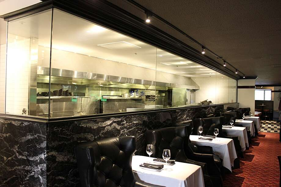 Osso Steakhouse: The kitchen, which was formerly open, has been glassed in.