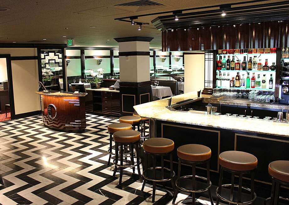Osso Steakhouse: The bar and host stand. Dining room in the distance.