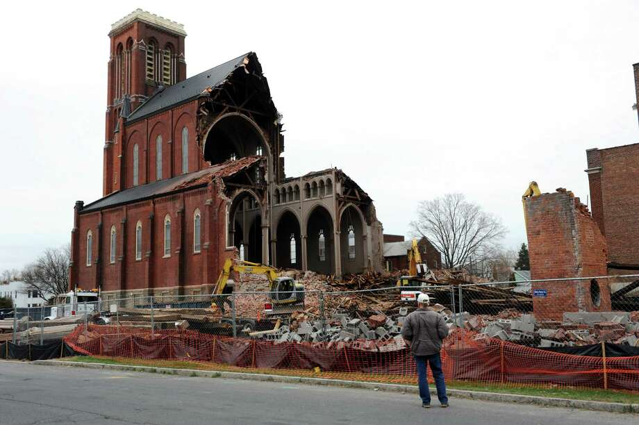 Bystanders stop to watch the demolition on Tuesday, April 23, 2013, at St. Patrick's Roman Catholic Church in Watervliet, N.Y. (Cindy Schultz / Times Union) Photo: Cindy Schultz / 10022070A