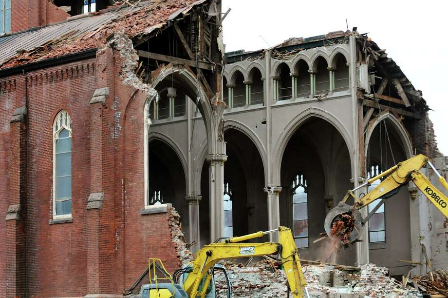 Demolition crews work to take down St. Patrick's Roman Catholic Church on Tuesday, April 23, 2013, in Watervliet, N.Y. (Cindy Schultz / Times Union) Photo: Cindy Schultz / 10022070A