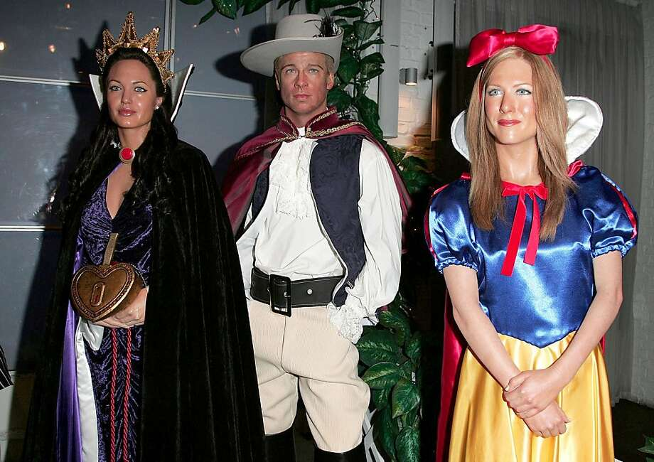 Jennifer Aniston waxwork as Snow White, Brad Pitt waxwork dressed up as Prince Charming and Angelina Jolie waxwork as the Wicked Stepmother. (Photo by Fred Duval/FilmMagic) Photo: Fred Duval