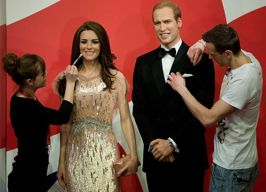 Employees pose putting the finishing touches to new waxwork statues of Britain's Prince William (R) and Catherine, Duchess of Cambridge (L) as they are unveiled at Madame Tussauds in Blackpool, north-west England on April 19, 2012. The Duchess is dressed in an exact copy of the stunning Jenny Packham dress she wore for the ARK charity dinner, the first time she and Prince William appeared as a married couple.  AFP PHOTO / ANDREW YATES (Photo credit should read ANDREW YATES/AFP/Getty Images) Photo: Andrew Yates, AFP/Getty Images