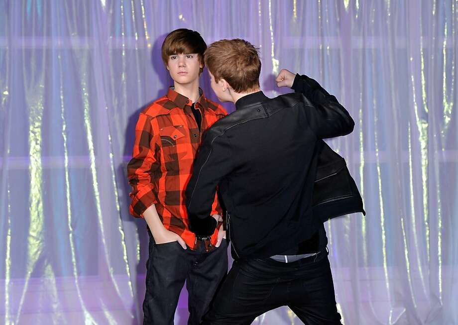 Justin Beiber (R) unveils his waxwork at Madame Tussauds on March 15, 2011 in London, England.  (Photo by Gareth Cattermole/Getty Images) Photo: Gareth Cattermole, Getty Images